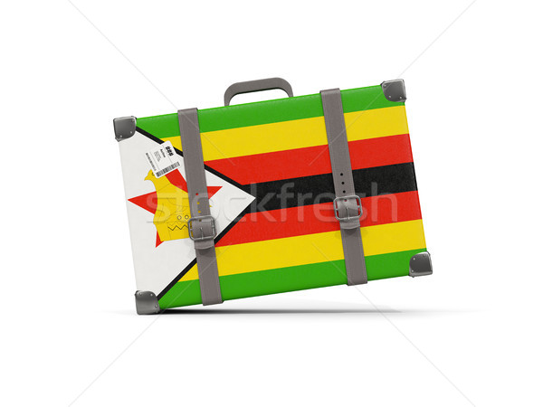 Luggage with flag of zimbabwe. Suitcase isolated on white Stock photo © MikhailMishchenko