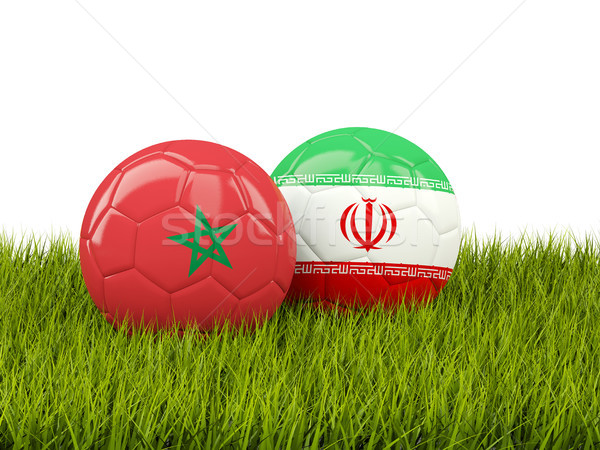 Morocco vs Iran. Soccer concept. Footballs with flags on green g Stock photo © MikhailMishchenko