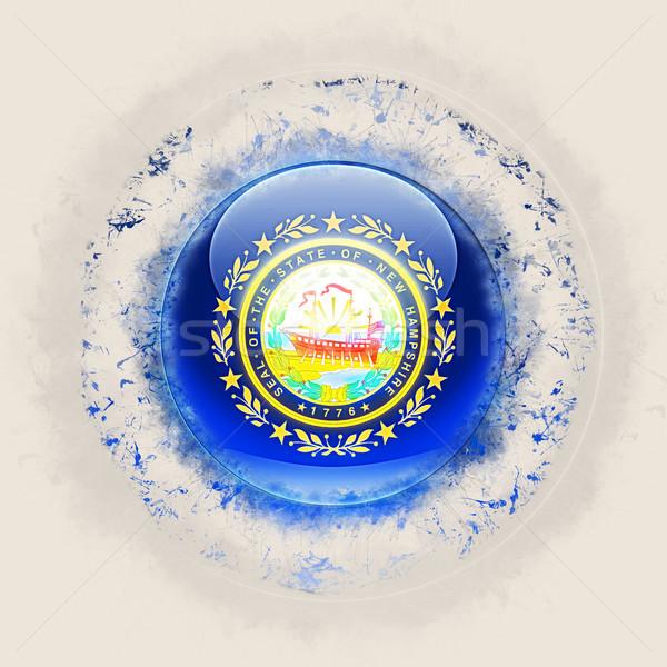 new hampshire state flag on a round grunge icon. United states l Stock photo © MikhailMishchenko