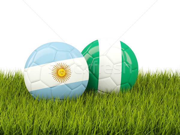 Argentina vs Nigeria. Soccer concept. Footballs with flags on gr Stock photo © MikhailMishchenko