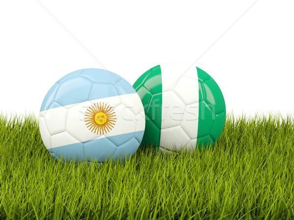 Argentinië vs Nigeria voetbal vlaggen groen gras Stockfoto © MikhailMishchenko