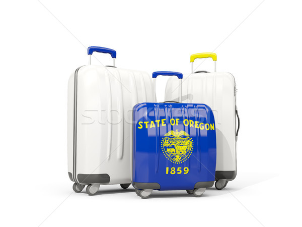 Luggage with flag of oregon. Three bags with united states local Stock photo © MikhailMishchenko