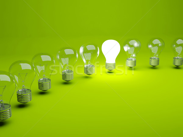 Stock photo: Row of light bulbs on green background