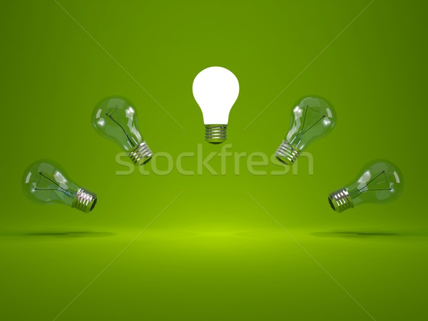 Stock photo: Light bulbs on green background