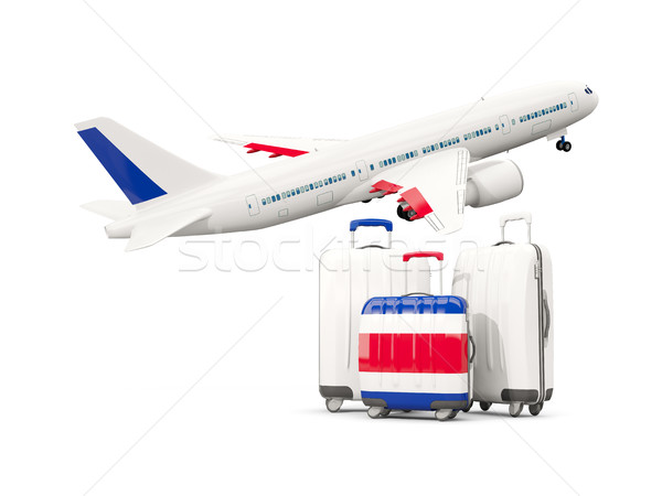 Luggage with flag of costa rica. Three bags with airplane Stock photo © MikhailMishchenko