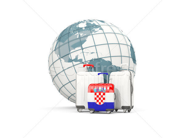 Luggage with flag of croatia. Three bags in front of globe Stock photo © MikhailMishchenko