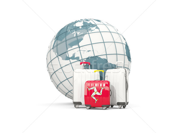 Luggage with flag of isle of man. Three bags in front of globe Stock photo © MikhailMishchenko