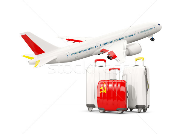 Luggage with flag of ussr. Three bags with airplane Stock photo © MikhailMishchenko