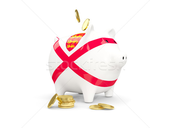 Fat piggy bank with fag of jersey Stock photo © MikhailMishchenko