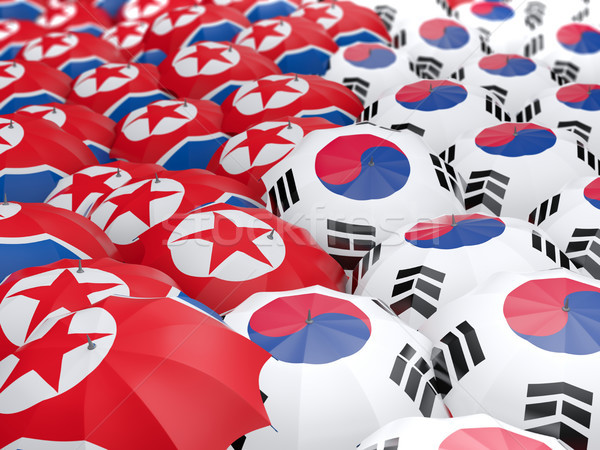 Stock photo: Flags of North Korea and South Korea on umbrellas