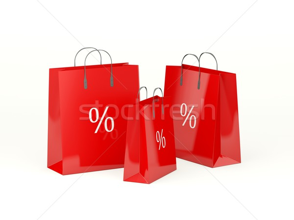 Three shopping bags isolated on white Stock photo © MikhailMishchenko