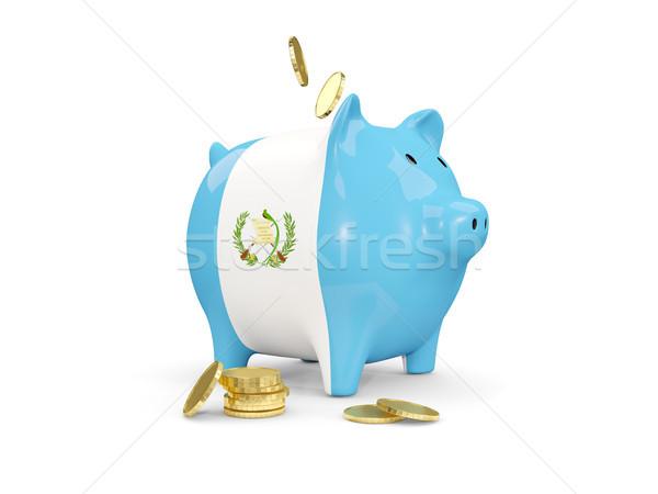 Fat piggy bank with fag of guatemala Stock photo © MikhailMishchenko
