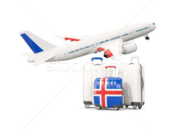 Luggage with flag of iceland. Three bags with airplane Stock photo © MikhailMishchenko