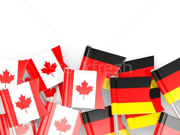 Flag pins of Canada and Germany isolated on white Stock photo © MikhailMishchenko