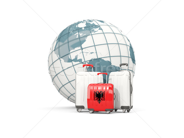 Luggage with flag of albania. Three bags in front of globe Stock photo © MikhailMishchenko