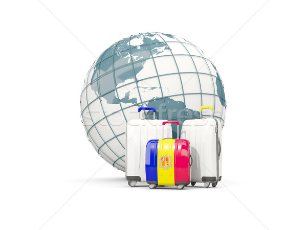 Luggage with flag of andorra. Three bags in front of globe Stock photo © MikhailMishchenko