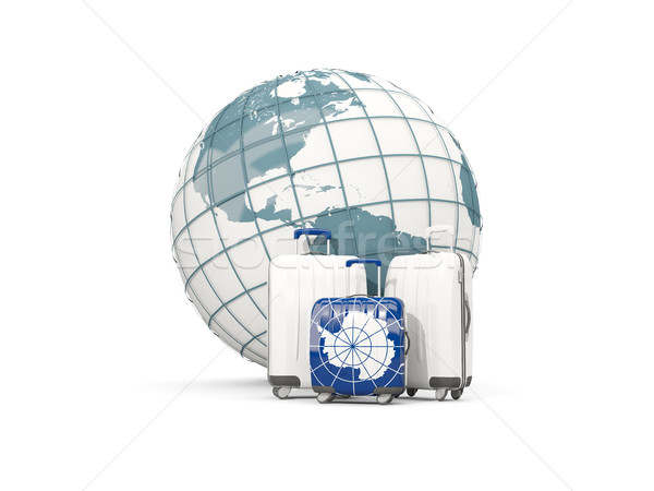Luggage with flag of antarctica. Three bags in front of globe Stock photo © MikhailMishchenko