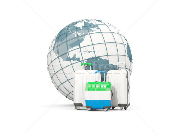 Luggage with flag of sierra leone. Three bags in front of globe Stock photo © MikhailMishchenko