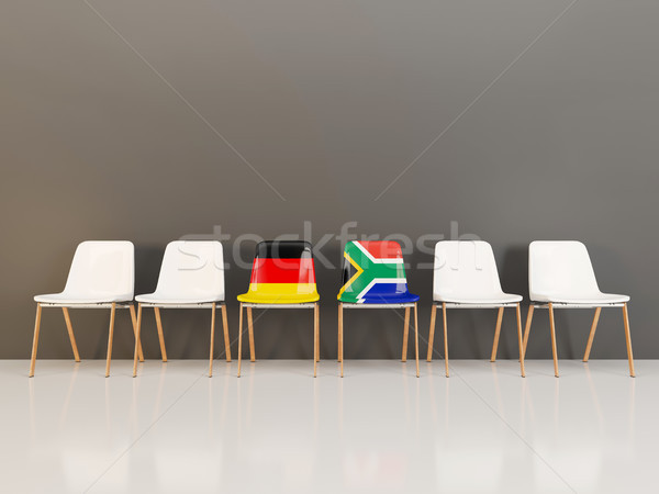Chairs with flag of Germany and south africa in a row Stock photo © MikhailMishchenko