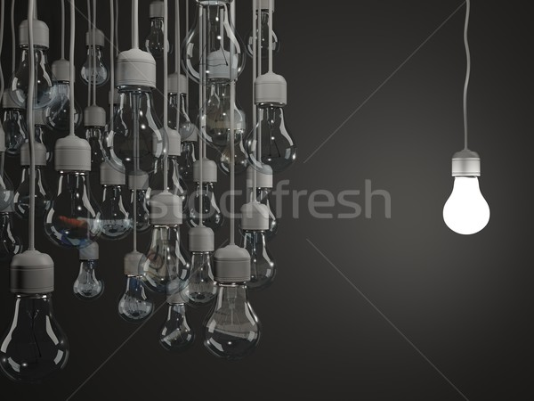 Stock photo: Bright light bulb on black background