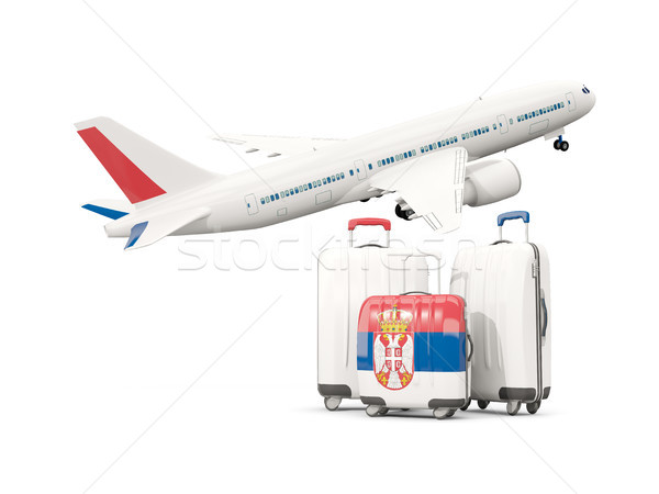 Luggage with flag of serbia. Three bags with airplane Stock photo © MikhailMishchenko
