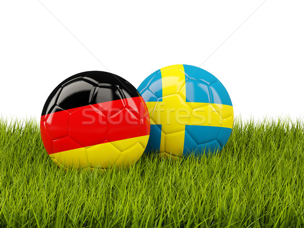 Germany vs Sweden. Soccer concept. Footballs with flags on green Stock photo © MikhailMishchenko