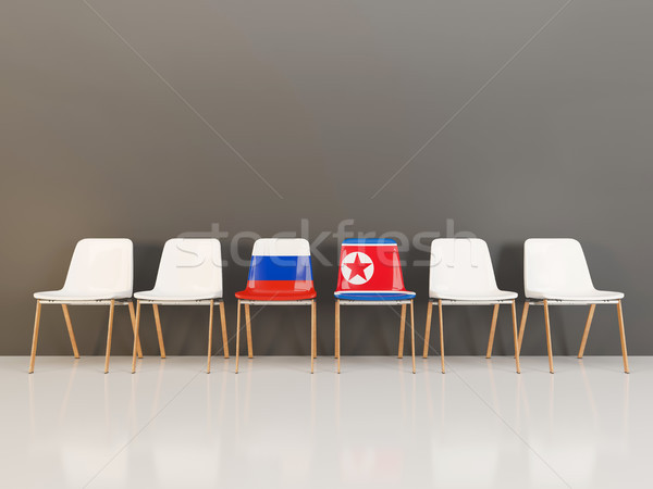 Chairs with flag of Russia and north korea Stock photo © MikhailMishchenko