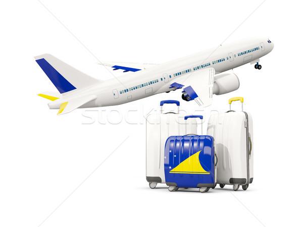 Luggage with flag of tokelau. Three bags with airplane Stock photo © MikhailMishchenko