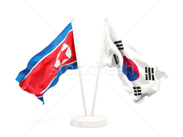 Stock photo: Two waving flags of North Korea and South Korea