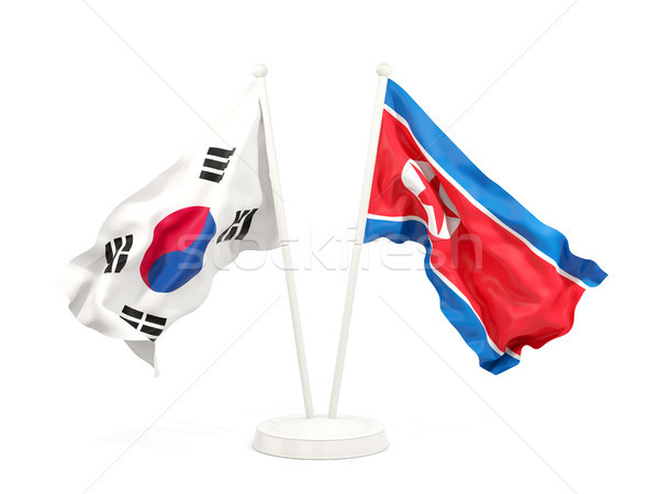 Dois bandeiras norte Coréia do Sul isolado Foto stock © MikhailMishchenko