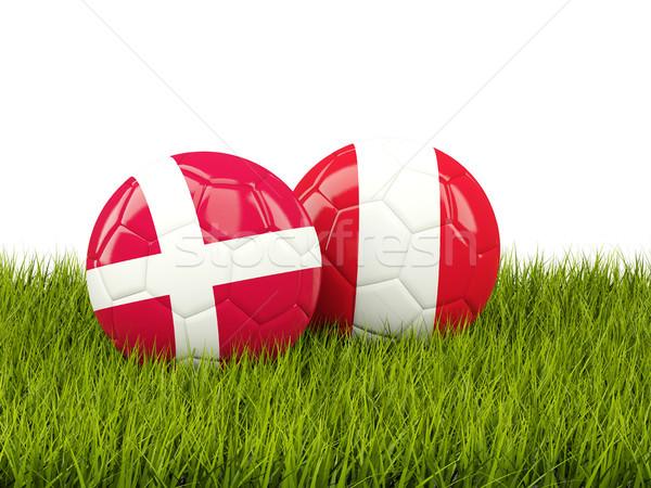 Denmark vs Peru. Soccer concept. Footballs with flags on green g Stock photo © MikhailMishchenko