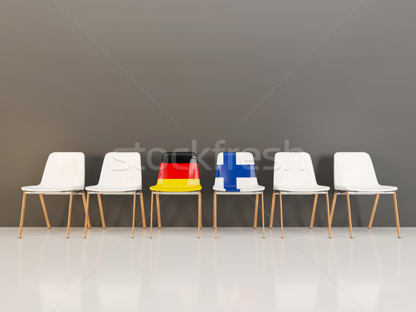 Chairs with flag of Germany and finland in a row Stock photo © MikhailMishchenko