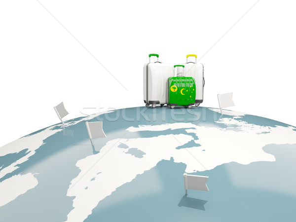 Stock photo: Luggage with flag of cocos islands. Three bags on top of globe