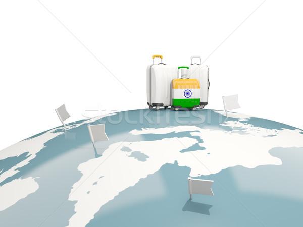Luggage with flag of india. Three bags on top of globe Stock photo © MikhailMishchenko