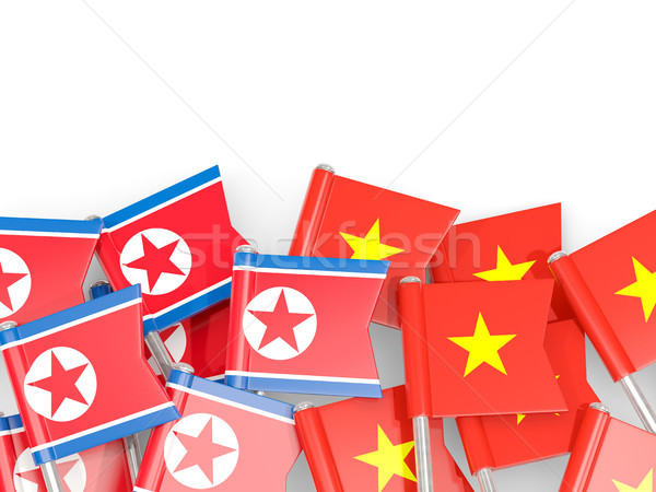 Flag pins of North Korea (DPRK) and Vietnam isolated on white Stock photo © MikhailMishchenko