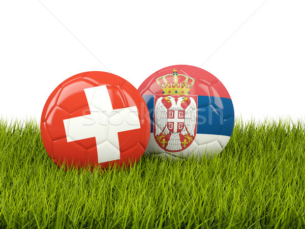 Suisse vs Serbie football drapeaux herbe verte Photo stock © MikhailMishchenko