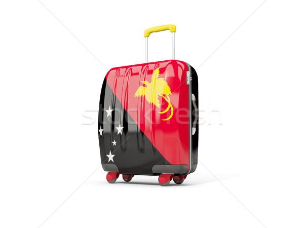 Luggage with flag of papua new guinea. Suitcase isolated on whit Stock photo © MikhailMishchenko