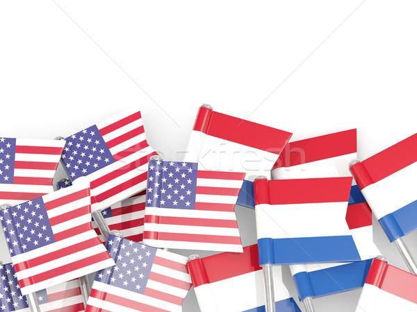 Flag pins of USA and Netherlands isolated on white. 3D illustrat Stock photo © MikhailMishchenko