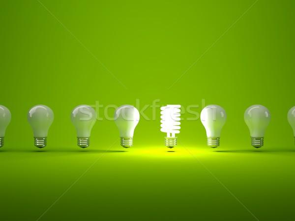 Stock photo: Row of light bulbs on green background