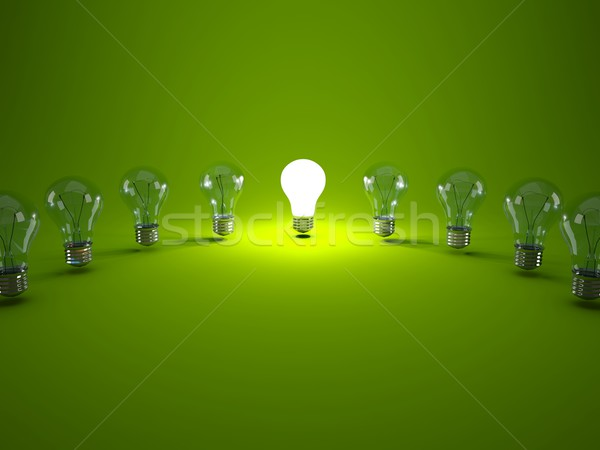 Row of light bulbs on green background Stock photo © MikhailMishchenko