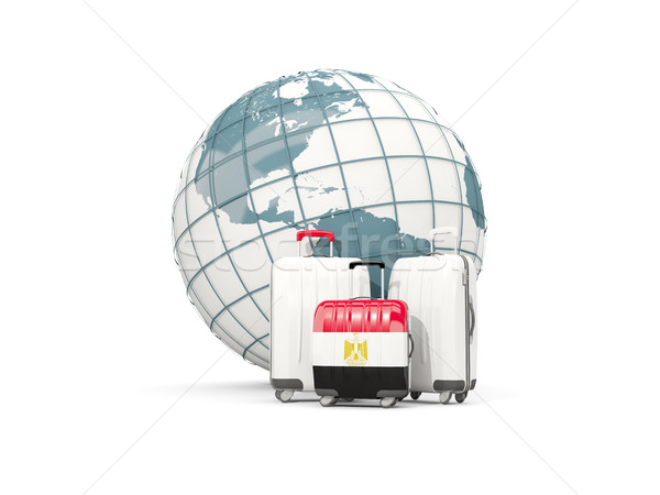 Luggage with flag of egypt. Three bags in front of globe Stock photo © MikhailMishchenko