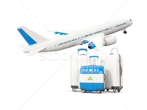 Csomagok zászló három szatyrok repülőgép izolált Stock fotó © MikhailMishchenko