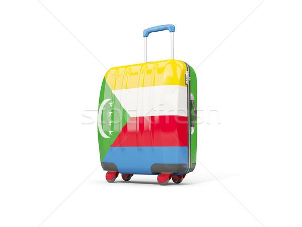 Luggage with flag of comoros. Suitcase isolated on white Stock photo © MikhailMishchenko