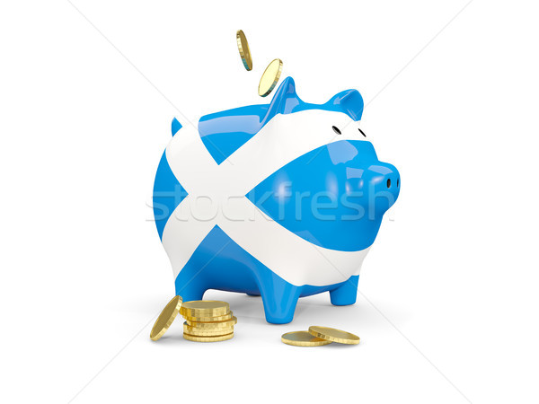Fat piggy bank with fag of scotland Stock photo © MikhailMishchenko