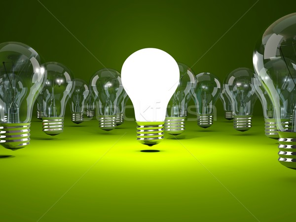 Light bulb on green background Stock photo © MikhailMishchenko
