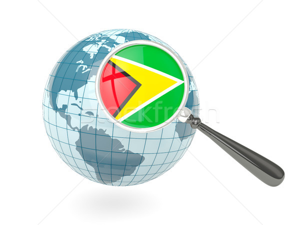 Magnified flag of guyana with blue globe Stock photo © MikhailMishchenko