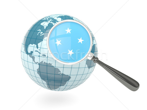 Magnified flag of micronesia with blue globe Stock photo © MikhailMishchenko