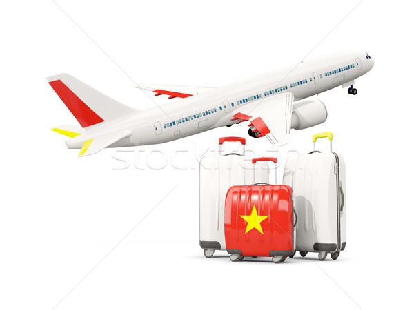 Luggage with flag of vietnam. Three bags with airplane Stock photo © MikhailMishchenko