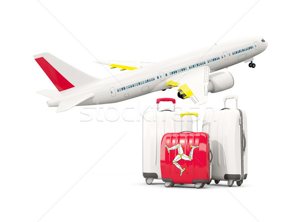 Luggage with flag of isle of man. Three bags with airplane Stock photo © MikhailMishchenko
