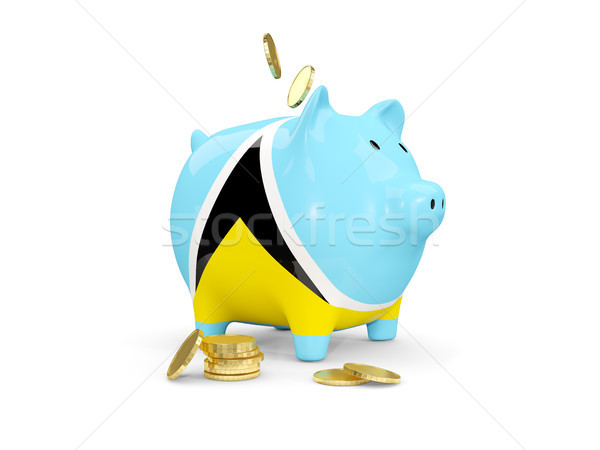 Fat piggy bank with fag of saint lucia Stock photo © MikhailMishchenko